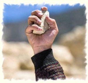hand throwing stone